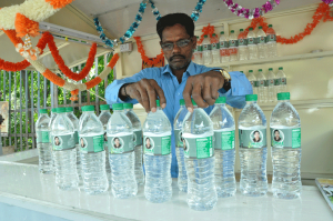 AMMA WATER BOTTLE SALES  AT MYLAPORE TANK ,EACH 10 RUPEES. ON 19-9-13