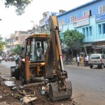 Civic workers clear South Mada Street of hawkers, goods