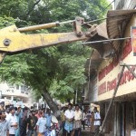 Corporation removes encroachments on pavements of R K Mutt Road