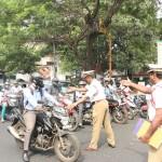 Traffic police enforce helmet rule for motorists