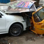 Porsche smashes into a tea stall and an auto; Auto driver seriously injured