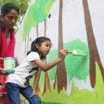 Venus Colony residents paint wall with visuals on civic issues
