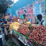 Summer season fruits sold on sidewalk