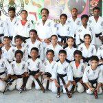 Students of local karate school get black belts