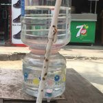A drink for the thirsty: Shopkeeper sets up a water can at R. A. Puram