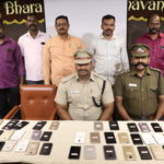 Police officials return lost/stolen phones to rightful owners