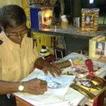 A creative security guard at Raja Street, Mandaveli
