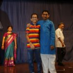 Two schoolboys make a mark on stage