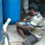 Water crisis: a resident constructs temporary RWH structure