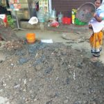 Civic workers clear storm water drains at Venkatesa Agraharam Street