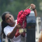Christians visit local cemeteries on day they pray for the dead