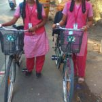 Free bicycles makes these girls happy