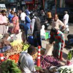 Frenetic shopping in big stores, business as usual on mada streets