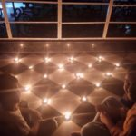 Residents of Rani Meyammai Towers at MRC Nagar light lamps on balconies and front porches