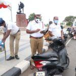 Fine traffic violators and offer kabasura kudineer. Traffic police in action.