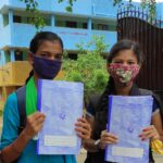 Collecting notebooks from school provided an opportunity to meet friends, say these local school girls