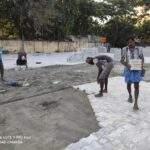 Tiling work on at Chennai Corporation' s large open space in R. A. Puram