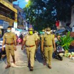 Policemen carry out foot patrolling in the neighbourhood