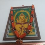 Amsa uses beads to create pictures of Hindu deities