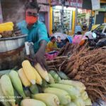 With the arrival of rainy season, hawkers sell corn, palmyra sprouts
