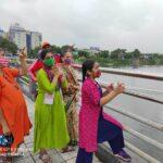 People stop by Thiru-Vi-Ka bridge to look at swollen Adyar river