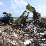 As huge mounds of waste gets washed up on Srinivasapuram shores, city officials oversee its removal