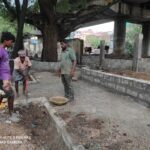 Civic workers construct broad pavements along the canal side of Kalvi Varu Street