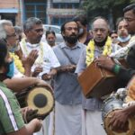 One group does bhajan rounds of mada veedhis on first day of margazhi