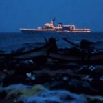 Navy Day: two illuminated ships  were anchored in sea off Light House